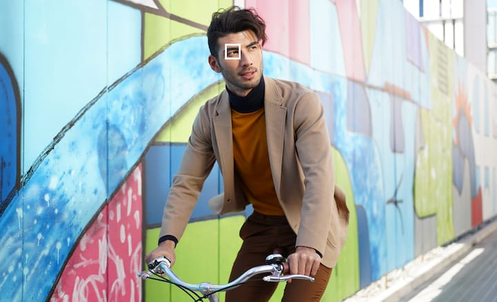 Image of a man riding a bicycle
