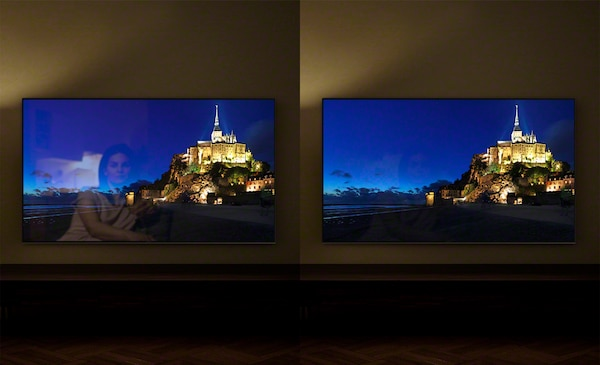 Images of a hilltop town at night on separate TV screens showing the benefit of X-Anti Reflection.