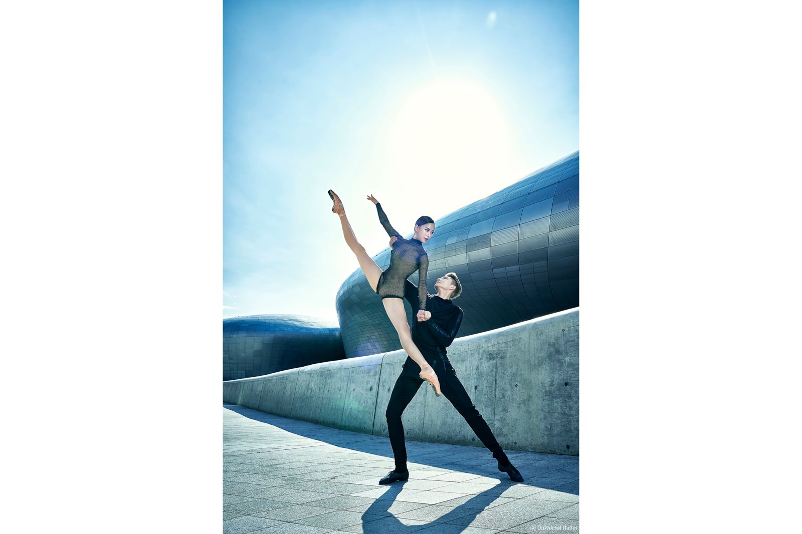 ballet couple in pose against building alpha 7RIII