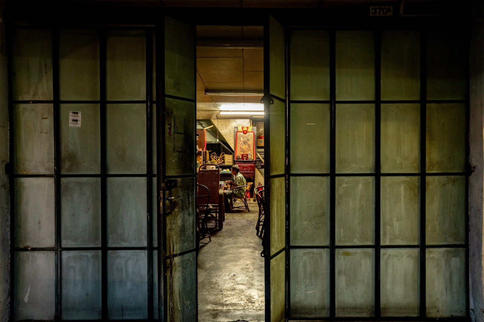 Doors partioning the interior of an old shophouse