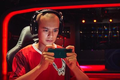 Man gaming with headphones on the Xperia 5 III