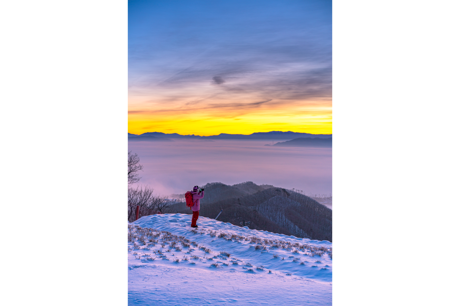 person on snowy mountain top alpha 7RIII