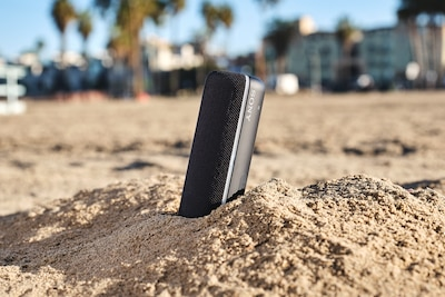 SRS-XB22 standing upright in sand