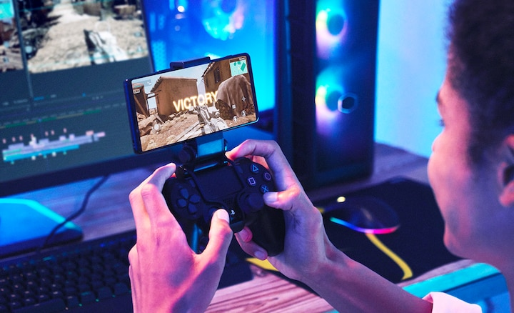 Person gaming on Xperia 1 III using dualshock controller