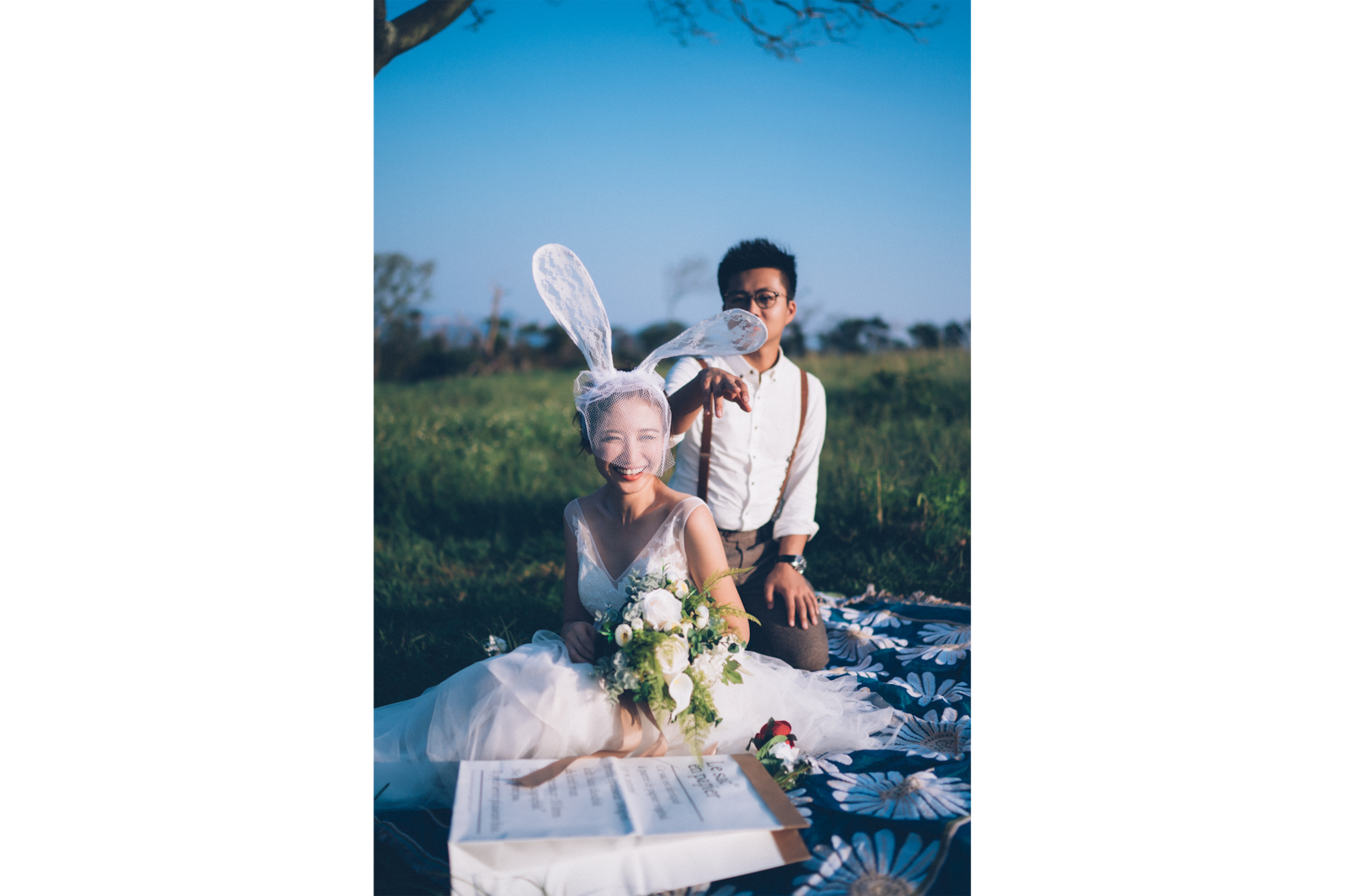 couple sitting in pasture wedding shoot alpha 9