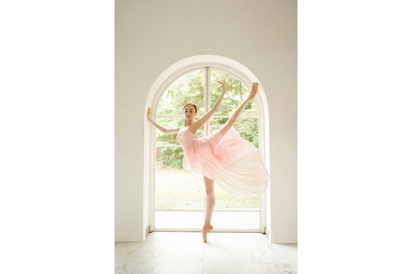 ballerine in pink dress against window alpha 7RIII